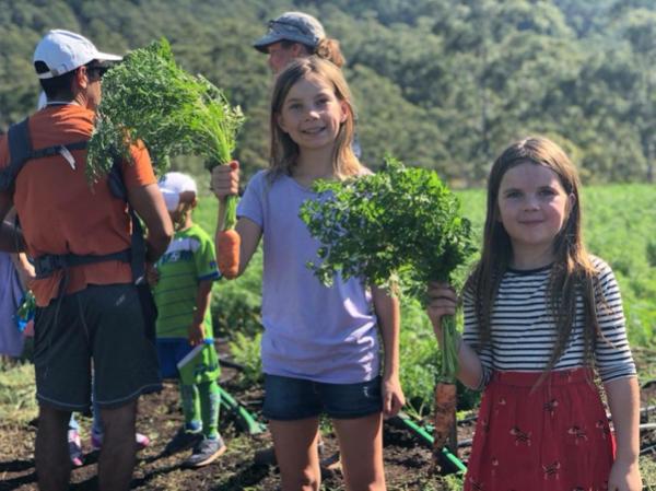 Summit Organics Farm Walk girls with carrots